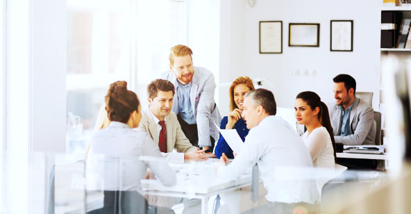 seven people having a meeting